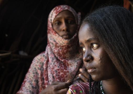 Afar woman having a traditional hairstyle inside her hut, Afar region, Afambo, Ethiopia