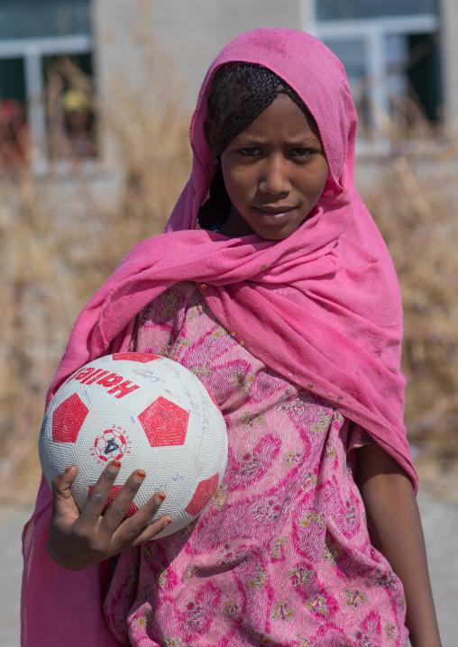 Portrait of an Afar tribe girl in pink veil with a ball, Afar region, Semera, Ethiopia