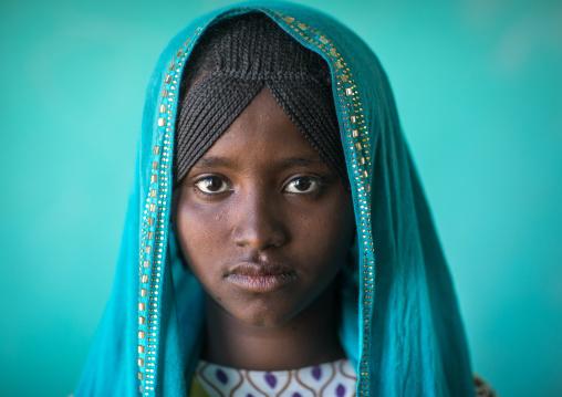Portrait of an Afar tribe girl with braided hair and a blue veil, Afar region, Semera, Ethiopia