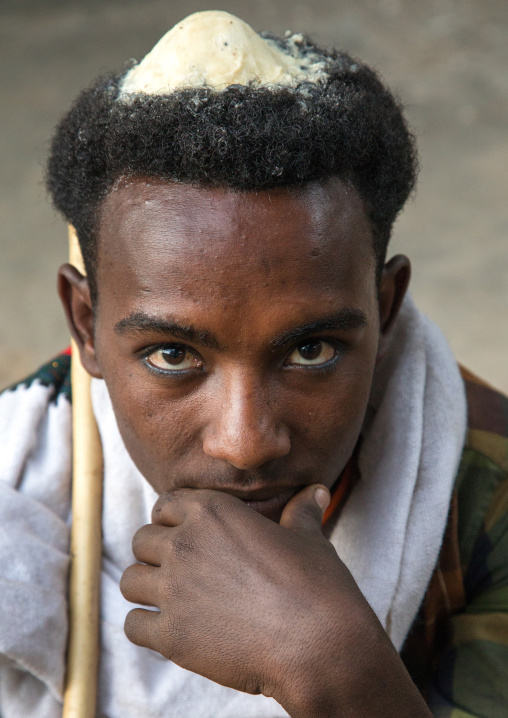 Portrait of a Raya tribe man with butter on his head to show he is on honeymoon, Amhara region, Gobiye, Ethiopia