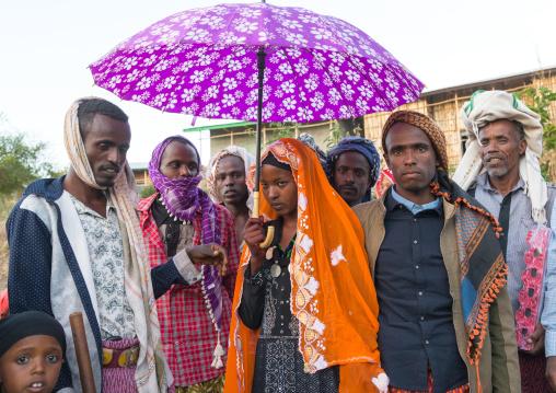 Oromo woman veiled during her wedding celebration with her husband and relatives, Amhara region, Artuma, Ethiopia