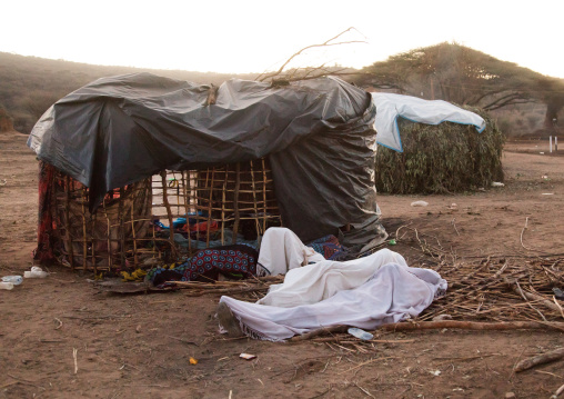 People sleeping wrapped in white clothes during the Gada system ceremony in Borana tribe, Oromia, Yabelo, Ethiopia