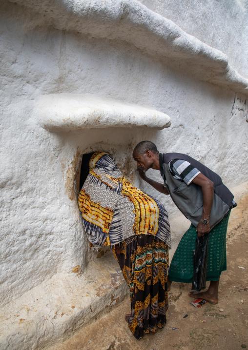 Oromo pilgrims looking inside the shrine which hosts the tomb of sufi Sheikh Hussein , Oromia, Sheik Hussein, Ethiopia