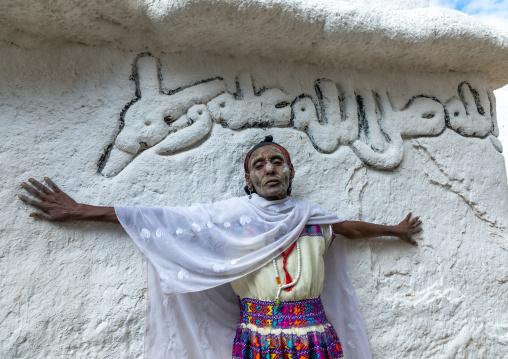 Oromo pilgrim woman in Sheikh Hussein shrine with jarawa powder on the face, Oromia, Sheik Hussein, Ethiopia