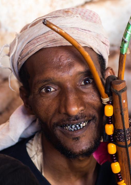 Oromo man with rooten teeth during Sheikh Hussein pilgrimage, Oromia, Sheik Hussein, Ethiopia