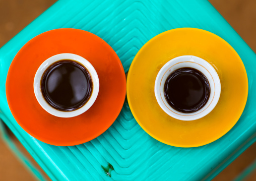 Two cups of coffee seen from above on a green plastic table, Omo valley, Key Afer, Ethiopia