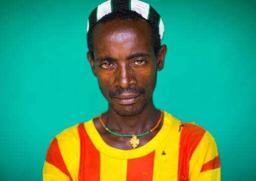 Portrait of a Hamer tribe man wearing a barcelona football shirt, Omo valley, Dimeka, Ethiopia