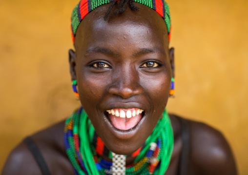 Portrait of a beautiful smiling Hamer tribe woman, Omo valley, Dimeka, Ethiopia