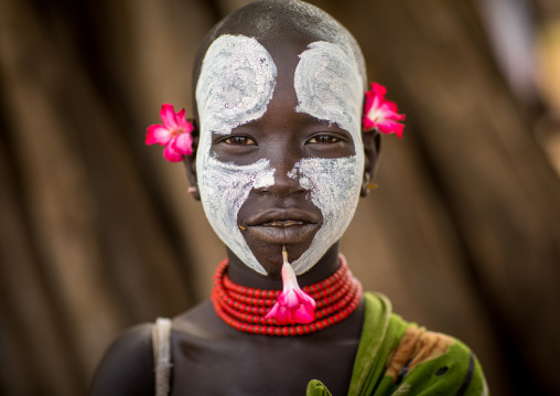 Portrait of a Karo tribe child with flowers decorations, Omo valley, Korcho, Ethiopia