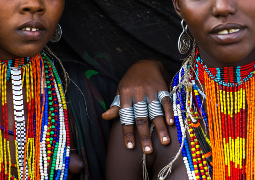 Erbore tribe women with black veils and colourful necklaces, Omo valley, Murale, Ethiopia