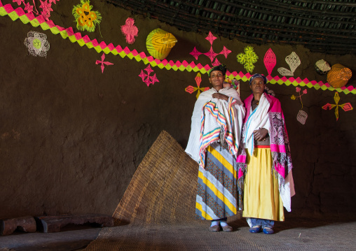 Portrait of Gurage women inside their traditional house decorated with doilies on the walls, Gurage Zone, Butajira, Ethiopia
