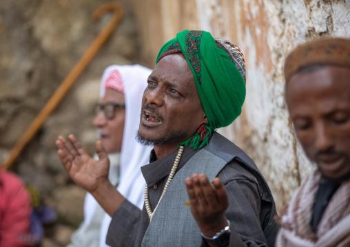 Harari islamic cleric praying during a sufi celebration, Harari Region, Harar, Ethiopia