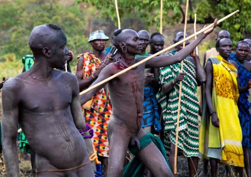 Suri tribe warrior bleeding during a donga stick fighting ritual, Omo valley, Kibish, Ethiopia