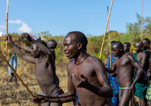 Suri tribe warriors parading before a donga stick fighting ritual, Omo valley, Kibish, Ethiopia