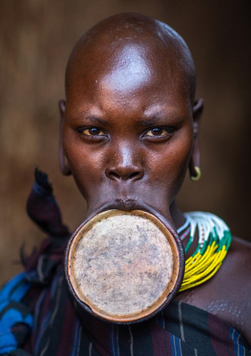 Portrait of a suri tribe woman wearing a lip plate, Omo valley, Kibish, Ethiopia