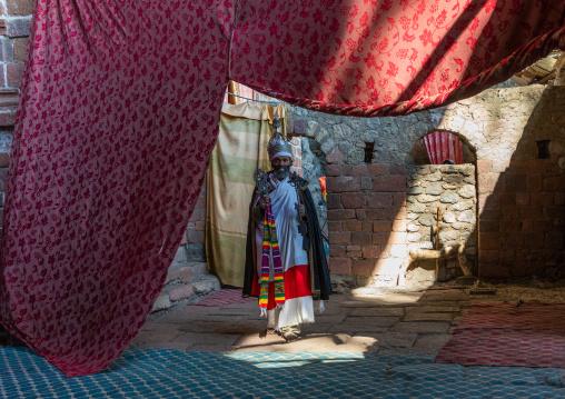 Ethiopian orthodox priest in nakuto lab rock church, Amhara Region, Lalibela, Ethiopia