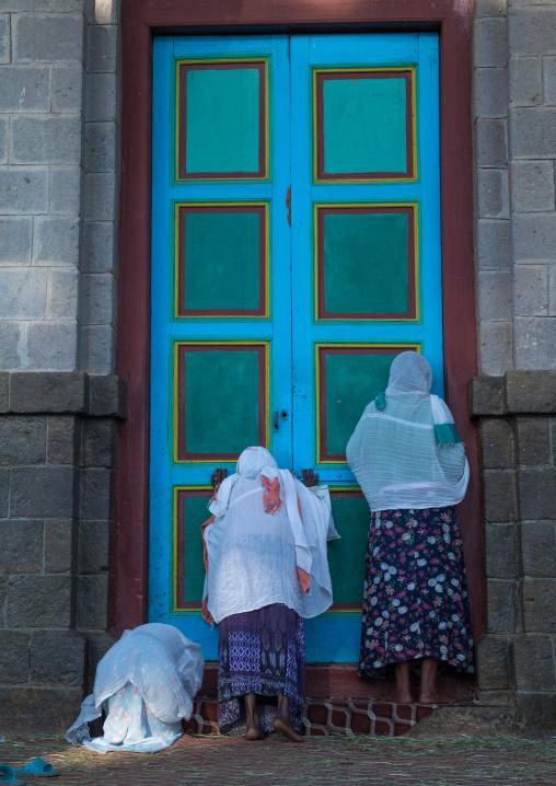Ethiopian orthodox women praying in front of Entoto orthodox Maryam Church, Addis Ababa Region, Addis Ababa, Ethiopia