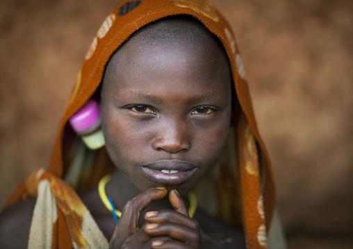 Suri tribe girl with enlarged earlobe, Kibish, Omo valley, Ethiopia