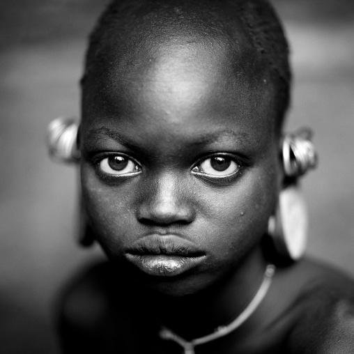 Suri tribe girl with enlarged earlobes, Kibish, Omo valley, Ethiopia