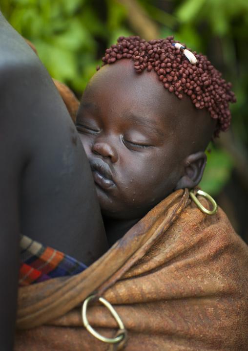 Bodi Tribe Baby Asleep With Coffee Bean Hairstyle, Hana Mursi, Omo Valley, Ethiopia