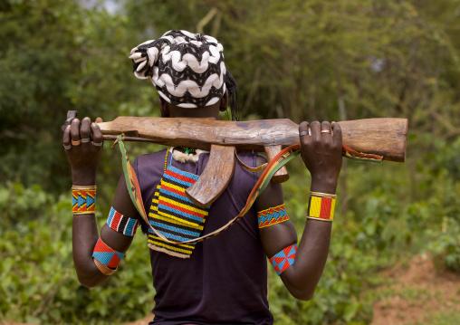 Bana Tribe  Man With A Wooden Kalshnikov, Key Afer, Omo Valley, Ethiopia
