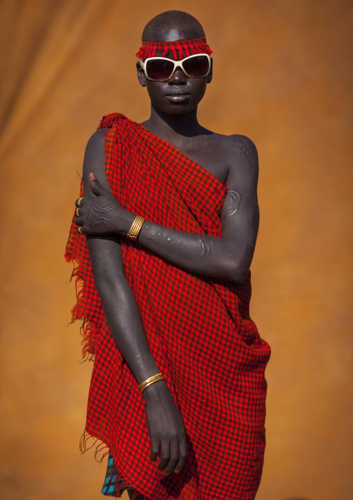 Bodi Tribe Young Woman With Sunglasses, Hana Mursi, Omo Valley, Ethiopia
