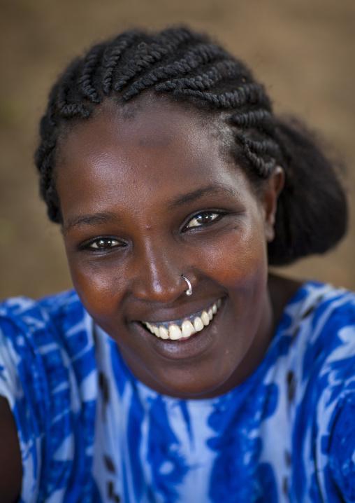 Smiling Ethiopian woman, Omorate, Omo valley, Ethiopia