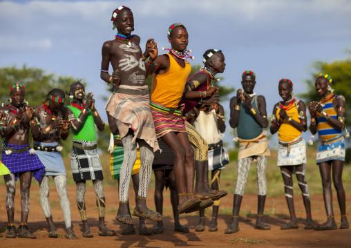 Bashada Tribe Men Dancing And Jumping, Dimeka, Omo Valley, Ethiopia