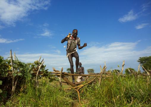 Bashada Tribe Man Jumping A Fence, Dimeka, Omo Valley, Ethiopia