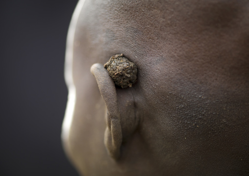 Karo Woman Shaved Head Detail Of Ear Carrying Piece Of Tobacco Ethiopia