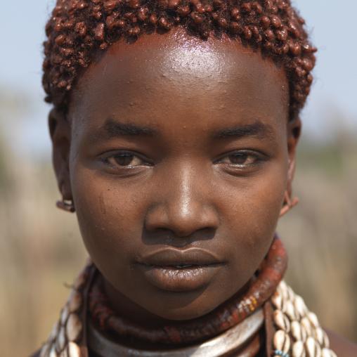 Portrait Of Ochre Dyed Short Hair Hamer Woman Ethiopia