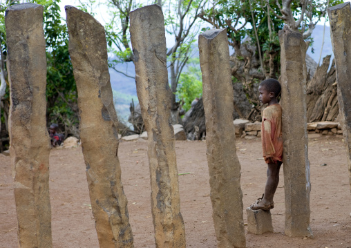 Kid Leaning On A Konso Stone Pillar In The Ceremony Square, Omo Valley, Ethiopia