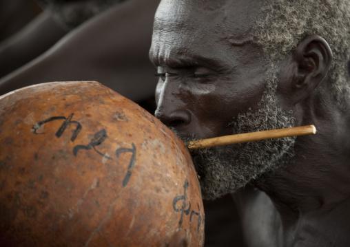 Senior Hamer Tribe Man Drinking From A Calabash, Omo Valley, Ethiopia
