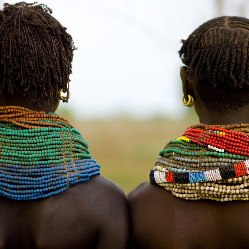 Rear View Of Nyangatom Tribe Women With Huge And Colourful Necklaces, Omo Valley, Kangate, Ethiopia