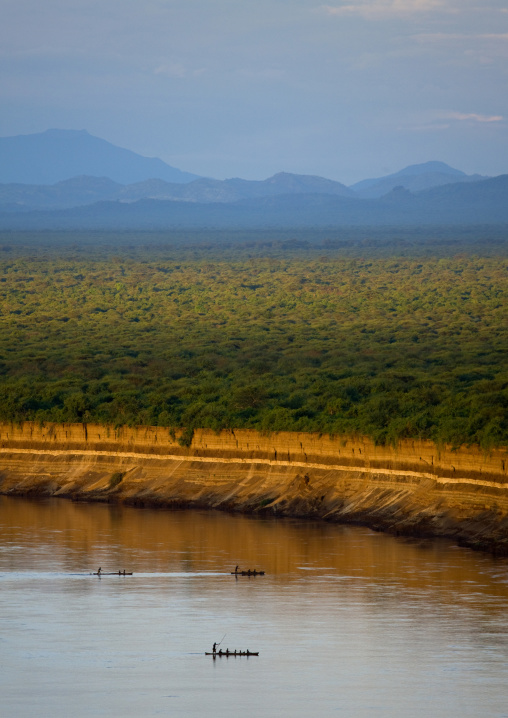 Boats Crossing Omo River With Mountains In The Background, Omo Valley, Ethiopia