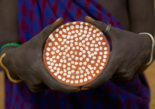 Mursi Tribe Woman Holding A Clay Lip Plate With White Dots, Omo Valley, Southern Ethiopia