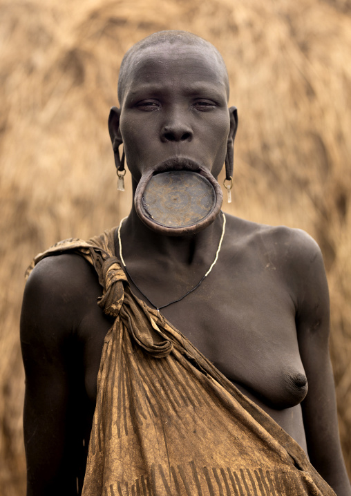 Portrait Of A Mursi Tribe Woman With Lip Plate And Enlarged Ears In Mago National Park, Omo Valley, Ethiopia
