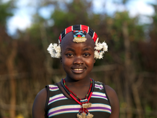 Portrait Of Cute Bashada Teenage Girl Wearing Traditional Headdress And Necklace Omo Valley Ethiopia