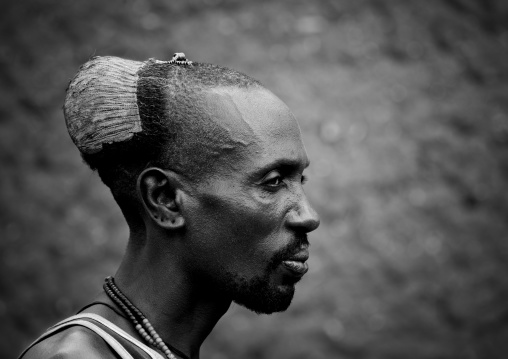 Black And White Profile Portrait Of Hamar Tribe Man With Mud Bun In Turmi, Omo Valley, Ethiopia