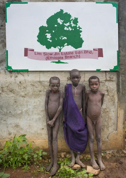 Suri kids at the entrance of a plantation, Koka, Omo valley, Ethiopia