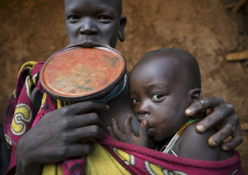 Suri Tribe Woman With A Lip Plate And Her Baby, Kibish, Omo Valley, Ethiopia