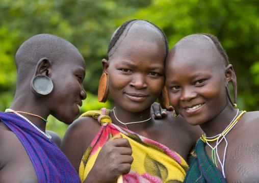 Suri tribe women with enlarged earlobe, Kibish, Ethiopia