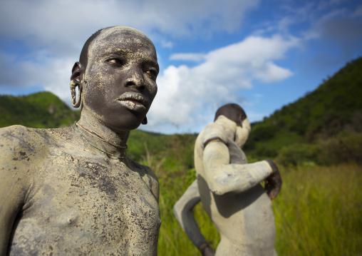Suri tribe shephers with body paintings as camouflage, Tulgit, Omo valley, Ethiopia