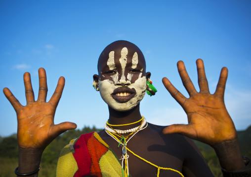 Suri tribe woman with body paintings, Tulgit, Omo valley, Ethiopia