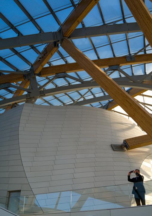 Visitor Taking Picture In Louis Vuitton Foundation, Bois De Boulogne, Paris, France