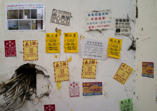 Advertisements on street walls for moving home, Special Administrative Region of the People's Republic of China, Hong Kong, China