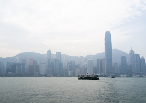 A star ferry leaving its Tsim Sha Tsui pier in kowloon to reach the central pier, Special Administrative Region of the People's Republic of China, Hong Kong, China