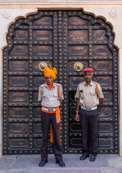 Indian guards in front of an old door in the city palace, Rajasthan, Jaipur, India