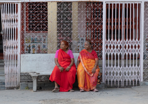 Portrait of rajasthani women sit on a bench in the street, Rajasthan, Jaipur, India