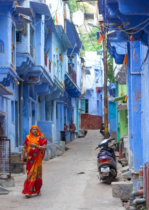 Rajasthani woman in traditional sari in the blue houses, Rajasthan, Bundi, India